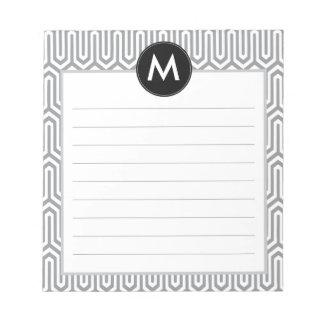 Inicial abstracta del monograma del modelo en gris bloc de papel