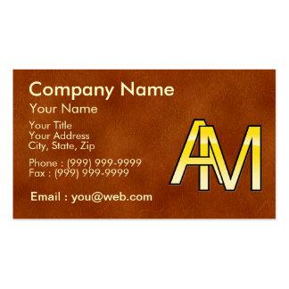 iniciales A y M en oro sobre fondo de cuero