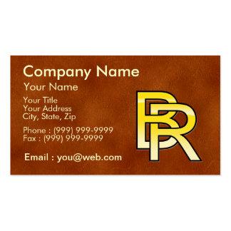 iniciales B y R en oro sobre fondo de cuero