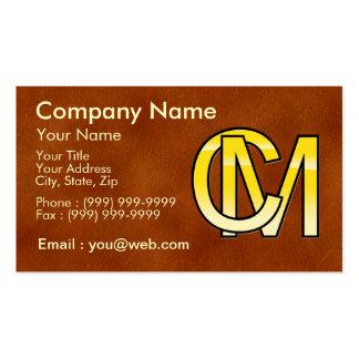 iniciales C y M en oro