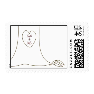 Initials carved in tree trunk postage stamp