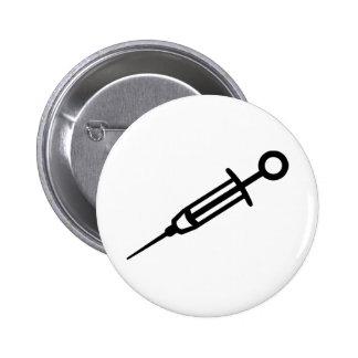 Injection syringe pinback button