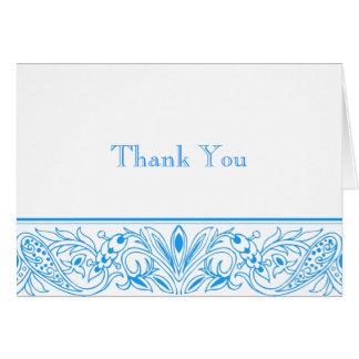 Inmóviles azules prístinos y le agradecen las tarjeta pequeña