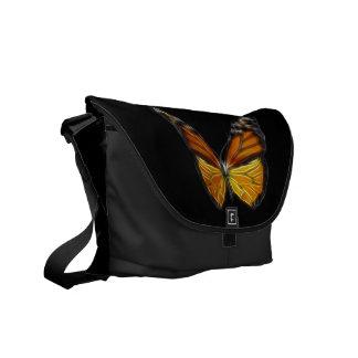 Insecto de vuelo anaranjado de la mariposa del mon bolsas messenger