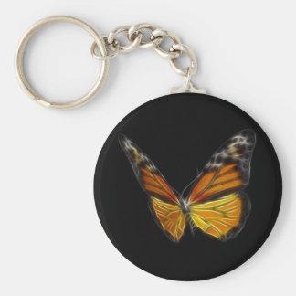 Insecto de vuelo anaranjado de la mariposa del mon llavero redondo tipo pin