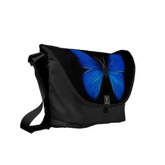 Insecto de vuelo azul de la mariposa bolsas messenger