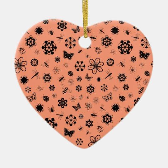Insectos y flores - fondo del vector del naranja adorno navideño de cerámica en forma de corazón