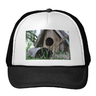 Insect's eye view of wooden bird house mesh hats