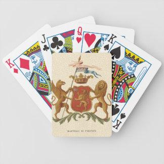 Insignia heráldica majestuosa con el grifo y el barajas de cartas