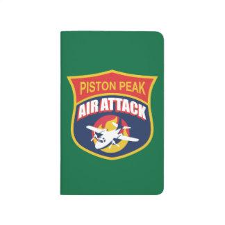 Insignia máxima del ataque aéreo del pistón cuaderno