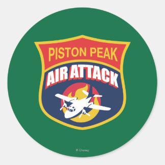 Insignia máxima del ataque aéreo del pistón etiquetas redondas