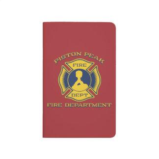 Insignia máxima del cuerpo de bomberos del pistón cuadernos grapados