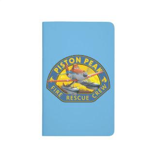 Insignia polvorienta del equipo de rescate del cuaderno grapado
