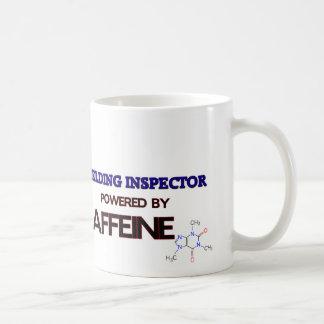 Inspector de la soldadura accionado por el cafeína taza