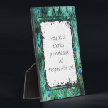 "Inspirational Quote On Kindness Spirit And Soul Plaque<br><div class=""desc"">Cute desk plaque with a wise inspirational motivational quotation which says: Every act of kindness grows the spirit and strengthens the soul. Set on a grungy style frame. The background is a pattern of peacock feathers. Colorful design in teal,  jewel green,  aqua blue and cobalt.</div>"