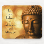 """Inspirational Quote with a Buddha Image Mouse Pad<br><div class=""""desc"""">Inspirational quote which reads: Life is a balance of holding on and letting go. Image is a serene and  peaceful bronze statue of the Buddha,  meditating with eyes closed. The background is bokeh style with  gold shiny lights blurred and out of focus.</div>"""