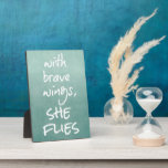 "Inspirational Quote: With Brave Wings, She Flies Plaque<br><div class=""desc"">Inspirational Quote: With Brave Wings,  She Flies plaques with beautiful aqua water color background and white font. See more &quot;She Quotes&quot; at Motivate Me. Link below:</div>"