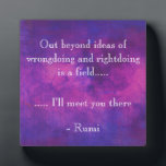 """Inspirational Rumi Quote on a Purple Background Plaque<br><div class=""""desc"""">Inspirational quote by the persian poet, Rumi. Reads: Out beyond ideas of wrongdoing and rightdoing is a field... .. ... .. i&#39;ll meet you there. This inspiring quotation is written on a purple and pink abstract watercolor background with glowing highlights. These vibrant watercolors mix and mingle together creating a simple,...</div>"""