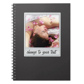 instant photo - photoframe - on black spiral note book