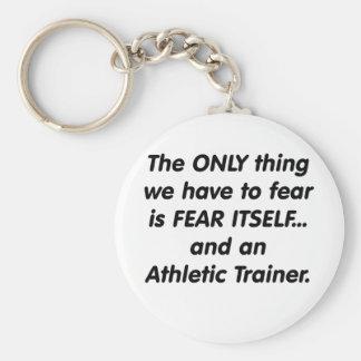 Instructor atlético del miedo llavero redondo tipo pin