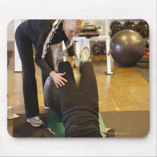 Instructor helps senior client with stretches mouse pad