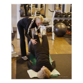 Instructor helps senior client with stretches poster