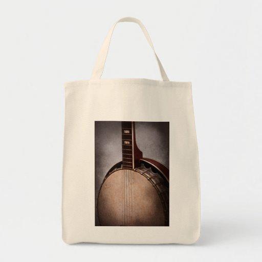 Instrumento - secuencia - un banjo típico bolsa de mano