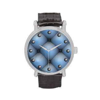 Interior de cuero azul del pliegue y del rollo reloj