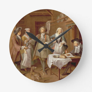 Interior of a Kitchen with Figures Tasting Wine Round Clock