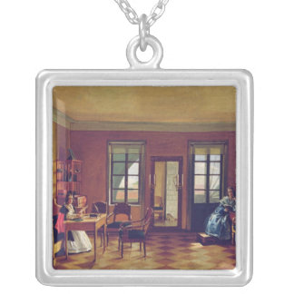 Interior of an attic square pendant necklace