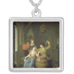 Interior with a couple celebrating square pendant necklace