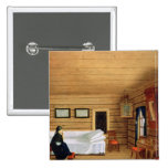 Interior with a seated woman pinback button
