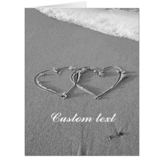 Interlocking hearts in beach sand greeting cards