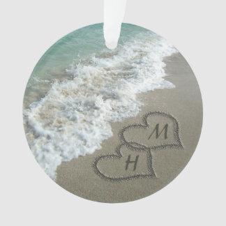 Interlocking Hearts on Beach Sand