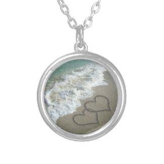 Interlocking Hearts on the Beach Pendant