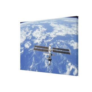 International Space Station orbiting Earth Canvas Print
