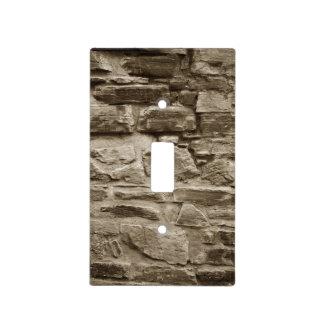 Interruptor de la luz en la pared de piedra placas para interruptor