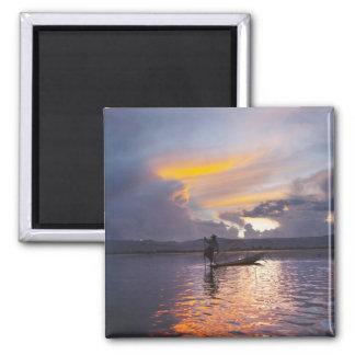 Intha fisherman leg rowing boat fishing with net magnet