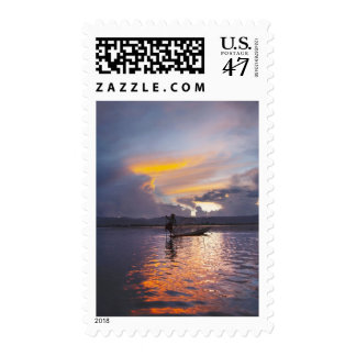 Intha fisherman leg rowing boat fishing with net postage
