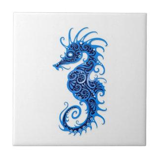 Intricate Blue Seahorse Design on White Ceramic Tile