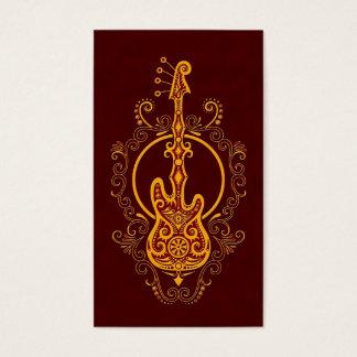 Intricate Golden Red Bass Guitar Design Business Card