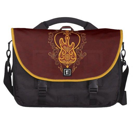 Intricate Golden Red Bass Guitar Design Laptop Bags