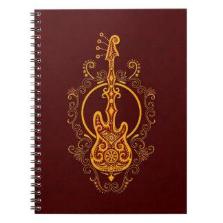 Intricate Golden Red Bass Guitar Design Notebook