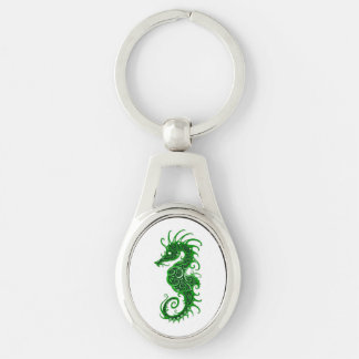 Intricate Green Seahorse Design on White Keychain