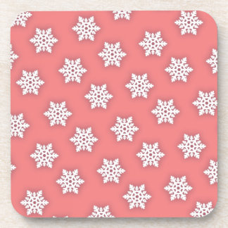 Intricate Snowflakes Against Soft Pink Beverage Coaster