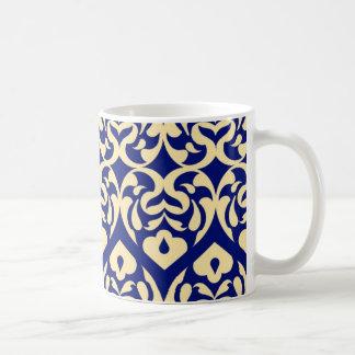 Intricate Yellow Heart Pattern Against Blue Mug