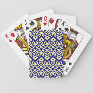 Intricate Yellow Heart Pattern Against Blue Playing Cards