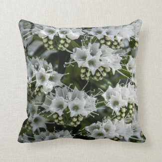 Intriguing little bursts of white clusters on this throw pillow