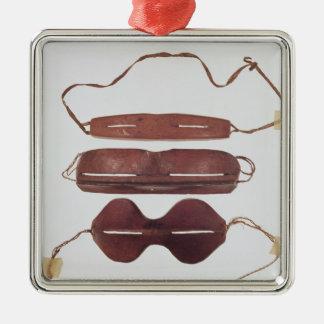 Inuit sun/snow 'glasses' metal ornament