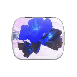 invert blue flowers against pink jelly belly candy tin